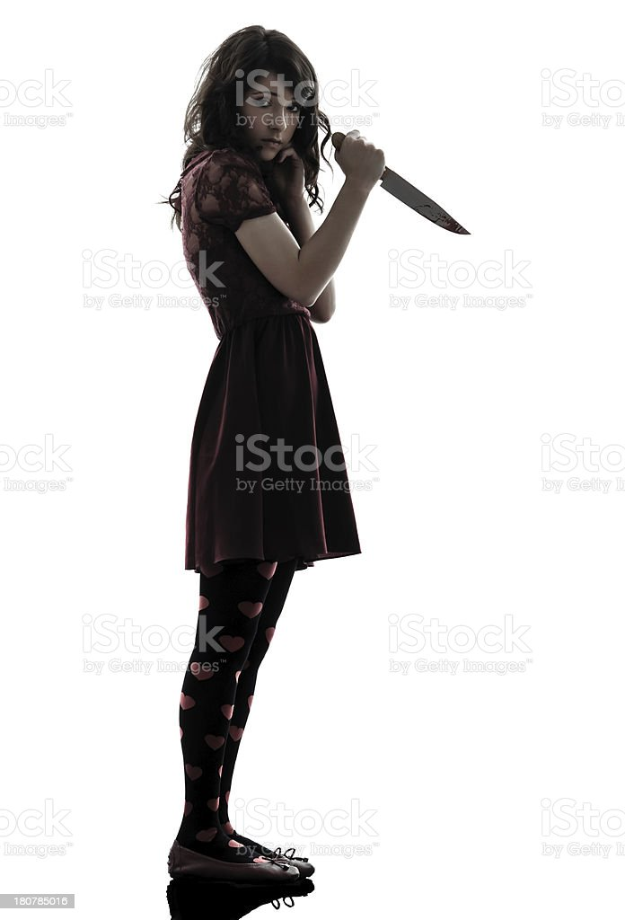 strange young woman killer holding bloody knife silhouette stock photo