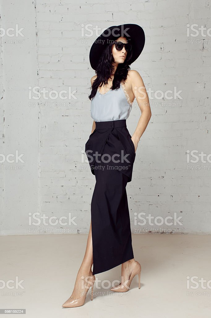 Stranger in black hat and sunglasses making a step stock photo