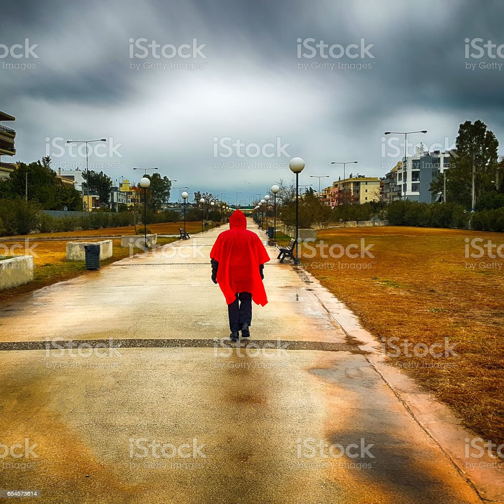 Stranger with a red coat. stock photo