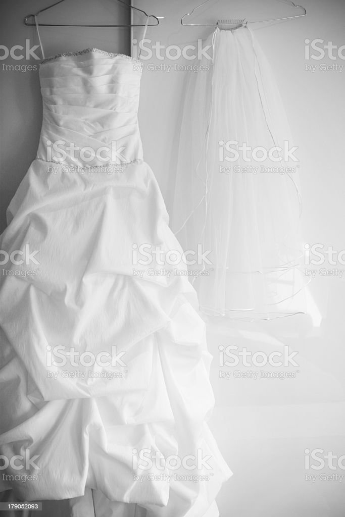 Strapless wedding dress with a long white veil stock photo