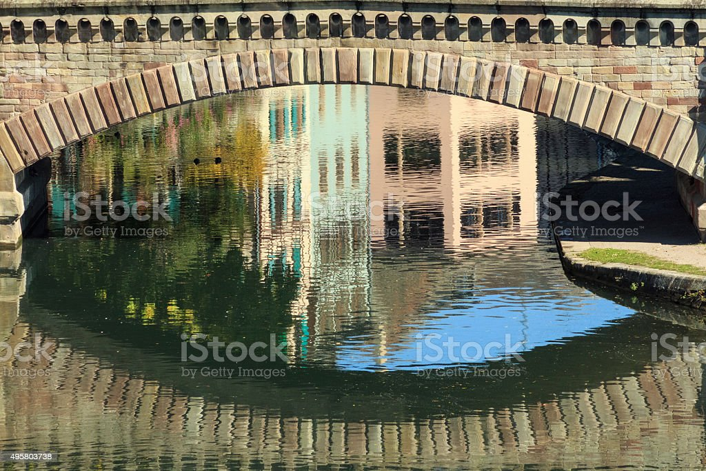 Strasbourg: Reflections of ancient houses in La Petite France stock photo