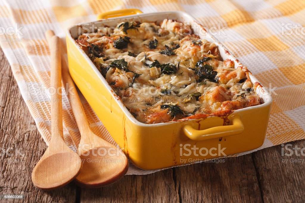 Strata casserole with spinach close up. Horizontal stock photo