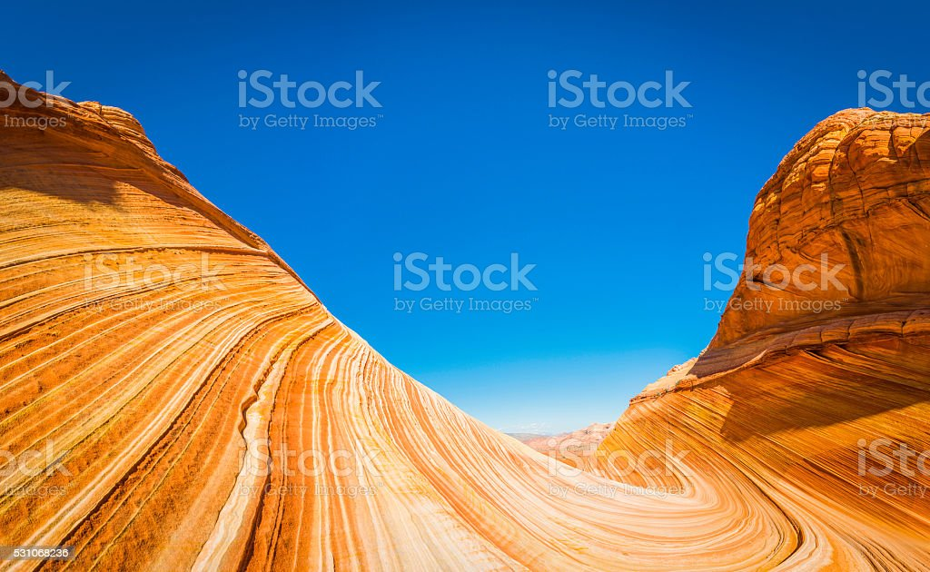 Strata swirling through desert canyon The Wave iconic landscape Arizona stock photo
