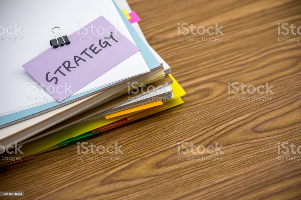 Strategy; The Pile of Business Documents on the Desk stock photo