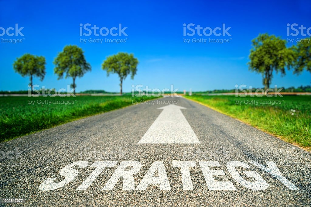 Strategy word painted on asphalt road royalty-free stock photo