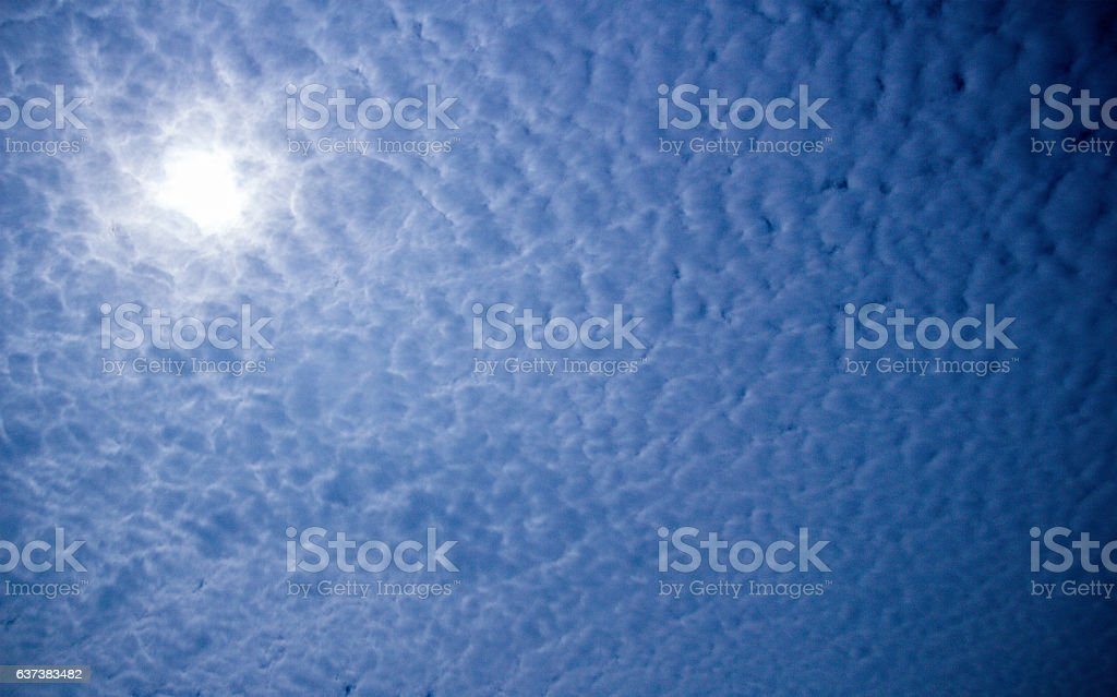 Stratus Clouds with bright sun stock photo