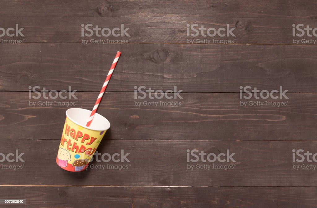 Straw and glass are on the wooden background stock photo