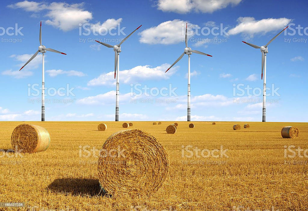 Straw bales and wind turbines royalty-free stock photo