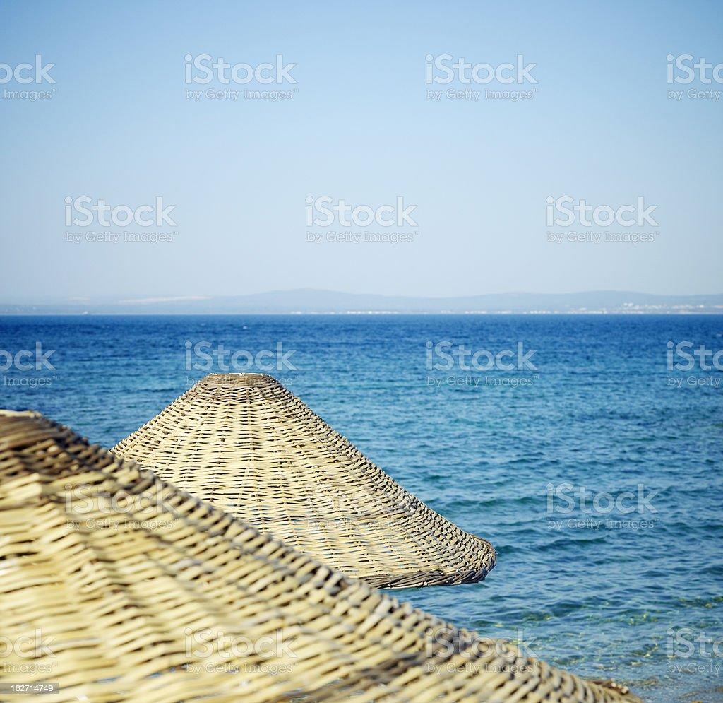 Straw beach umbrella stock photo