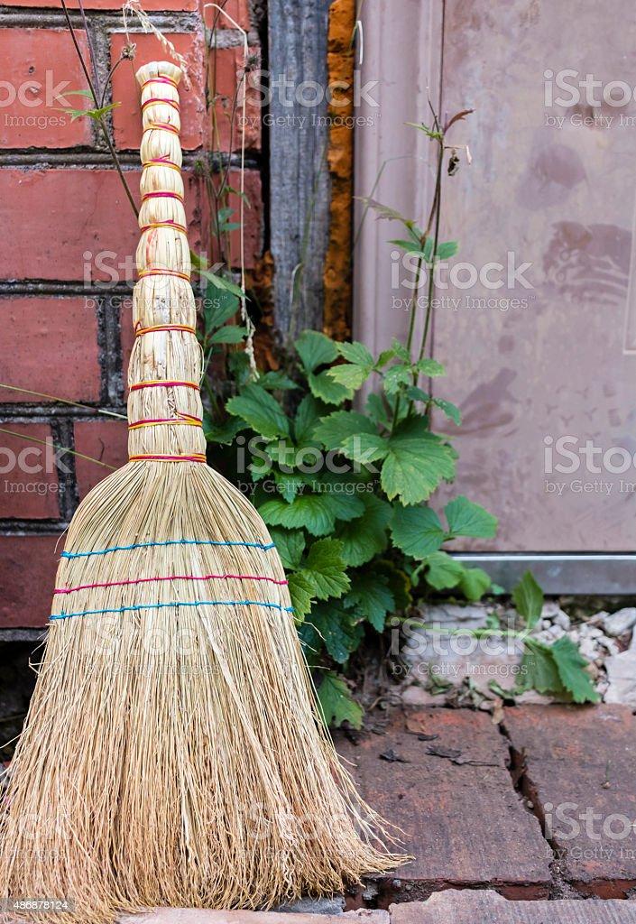 Straw Broom closeup stock photo