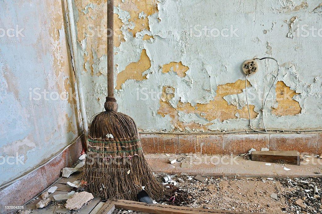 straw broom on filthy floor stock photo