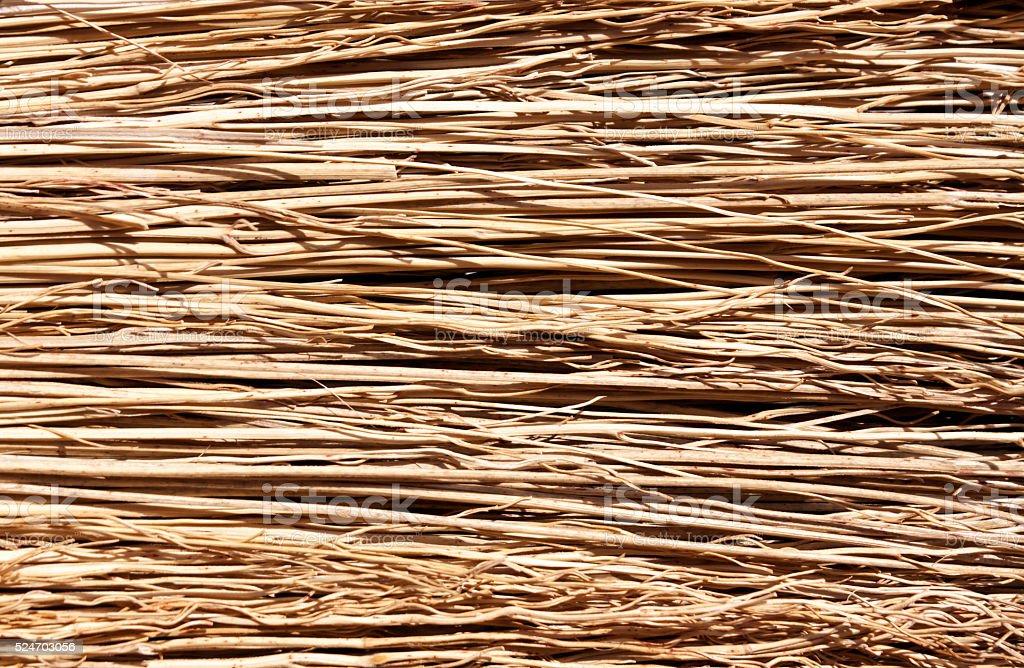 Straw broom texture. stock photo
