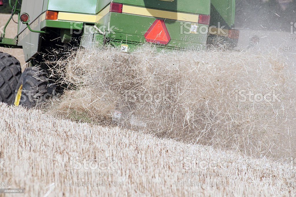 Straw chaff flung out behind a wheat harvester royalty-free stock photo
