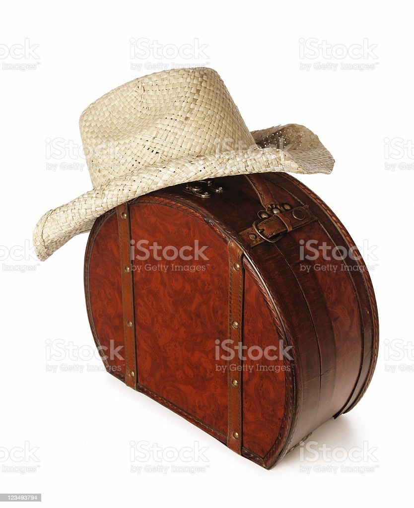 straw cowboy hat and suitcase royalty-free stock photo