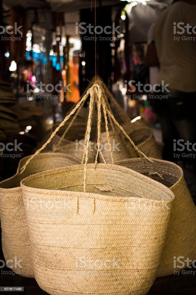 straw handbag sold at street fair stock photo