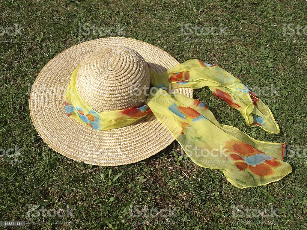Straw hat and colorful scarf, on sunny day. stock photo
