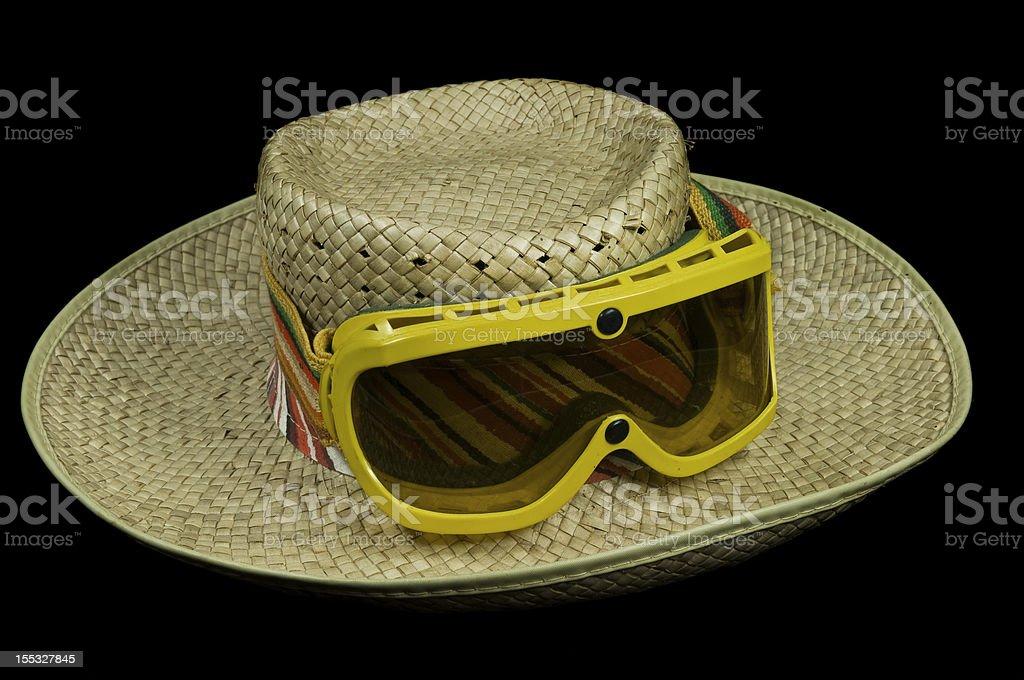 Chapéu de palha e óculos de proteção foto royalty-free