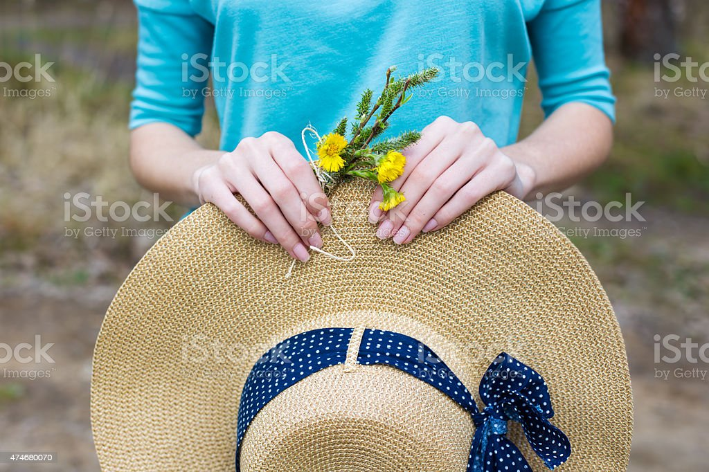 Straw hat and spring bouquet stock photo