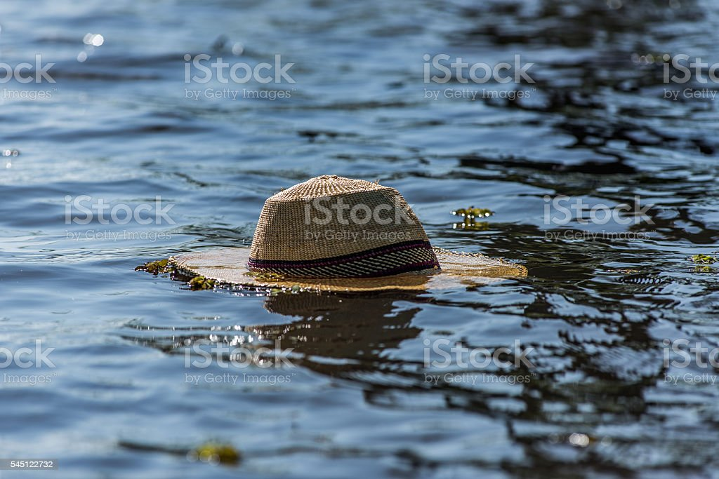 Straw Hat Floating stock photo