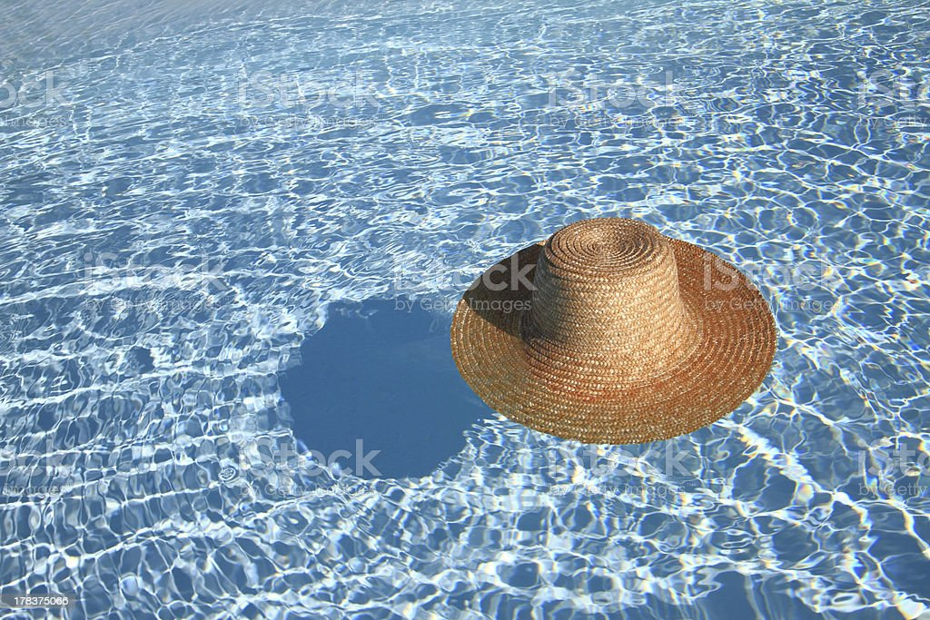 Straw hat in the pool stock photo