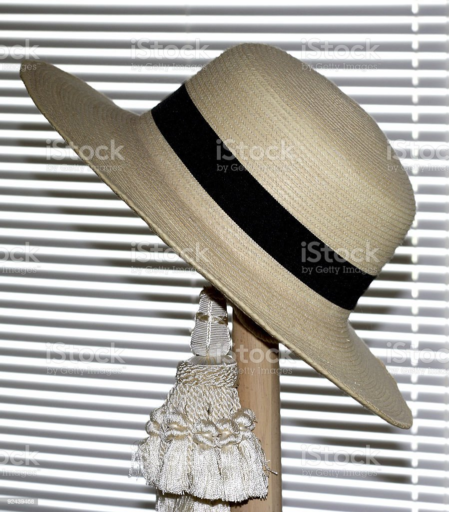 straw hat on bedpost royalty-free stock photo