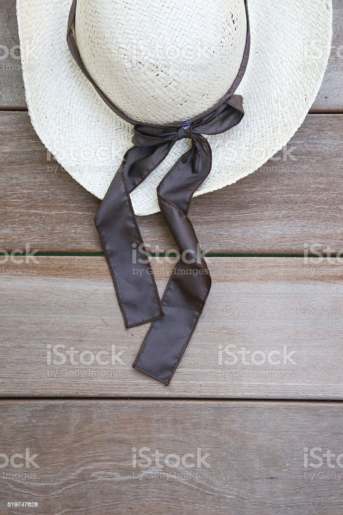 Straw hat on the wooden background stock photo