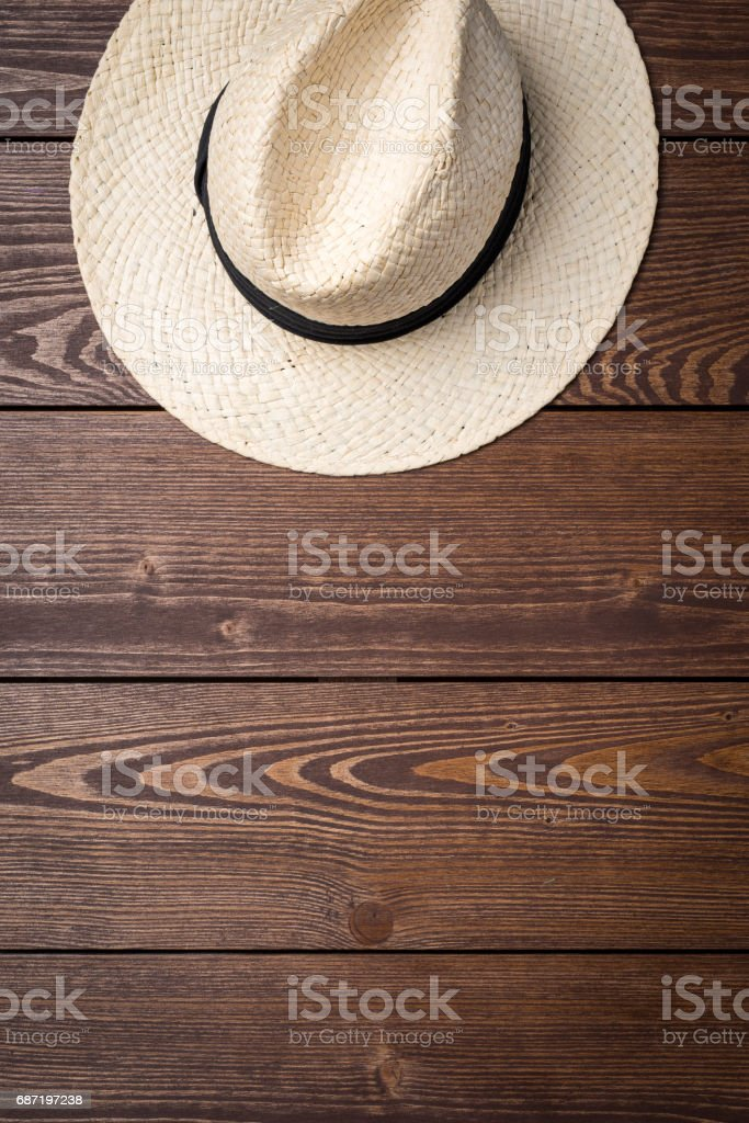 Straw hat on wooden table stock photo