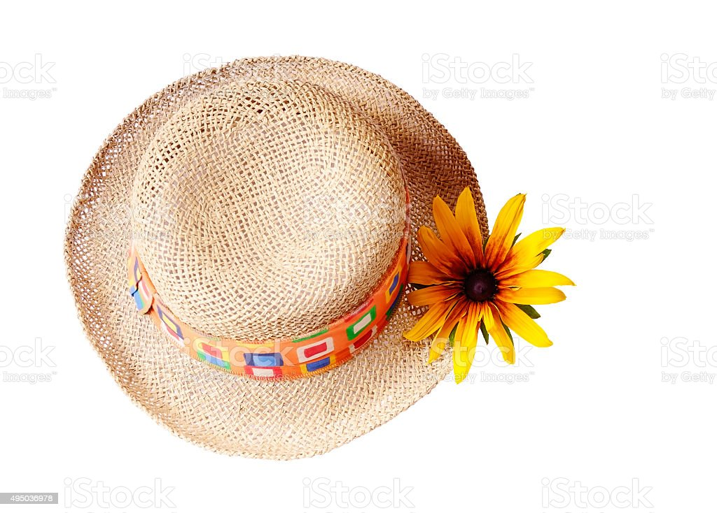 Straw hat with a flower, isolated stock photo