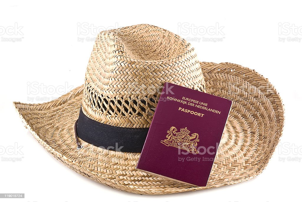 Straw hat with european passport. stock photo