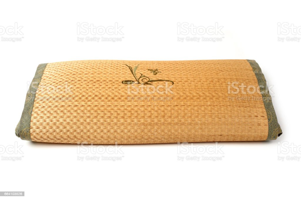 Straw woven pillow on white background stock photo