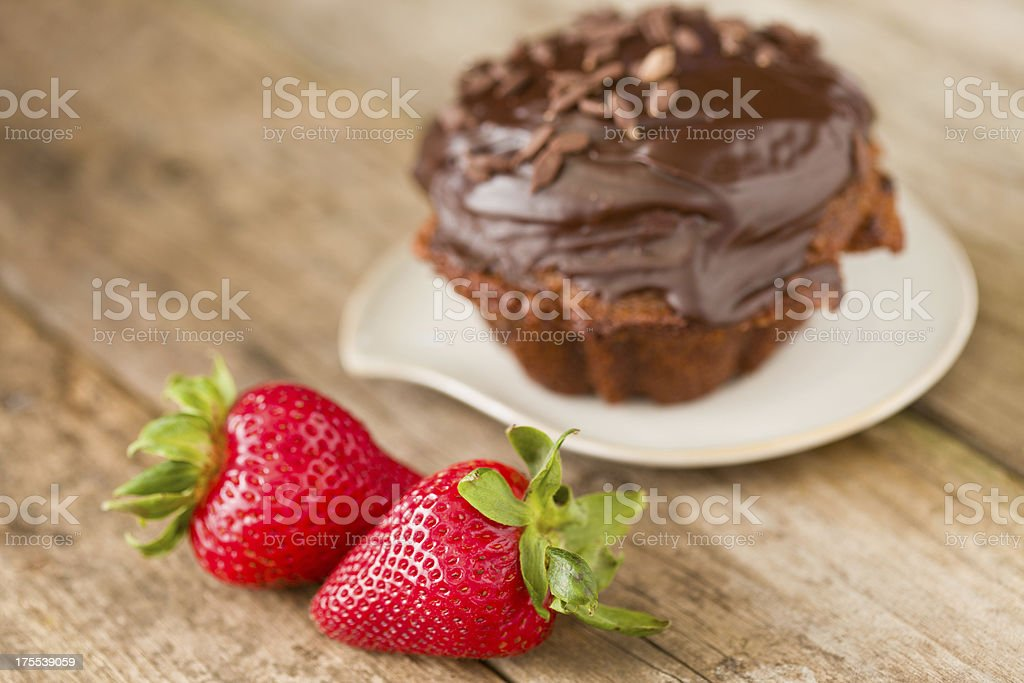 Strawberries And A Chocolate Cupcake stock photo