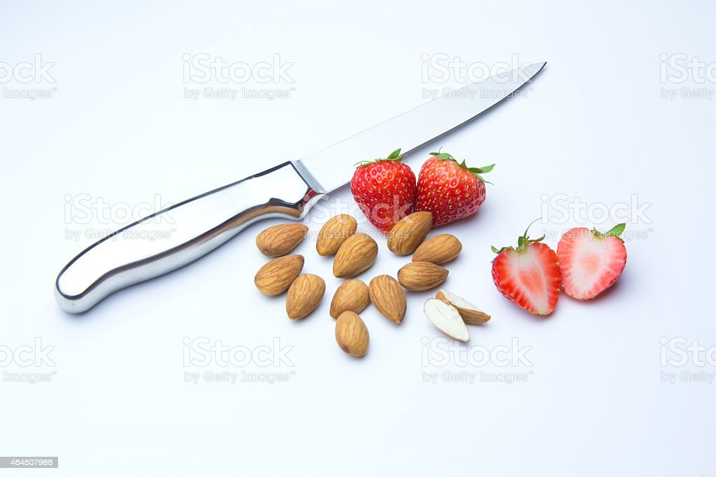 Strawberries and almonds isolated on white background royalty-free stock photo