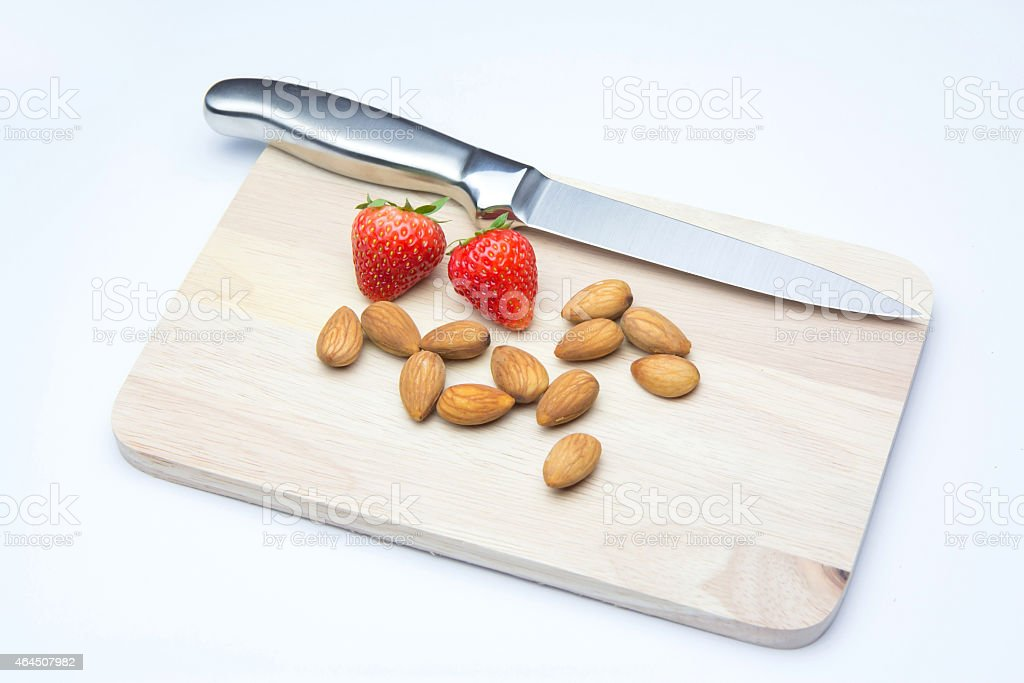 Strawberries and almonds on chopping block royalty-free stock photo
