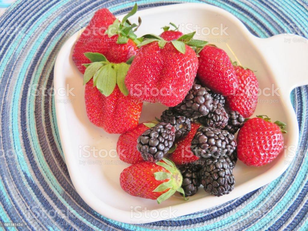 Strawberries and blackberries stock photo