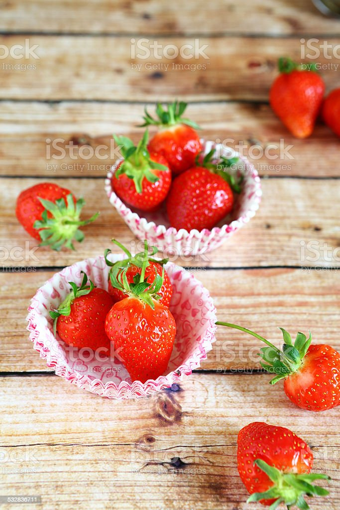 Strawberries and cake pans stock photo