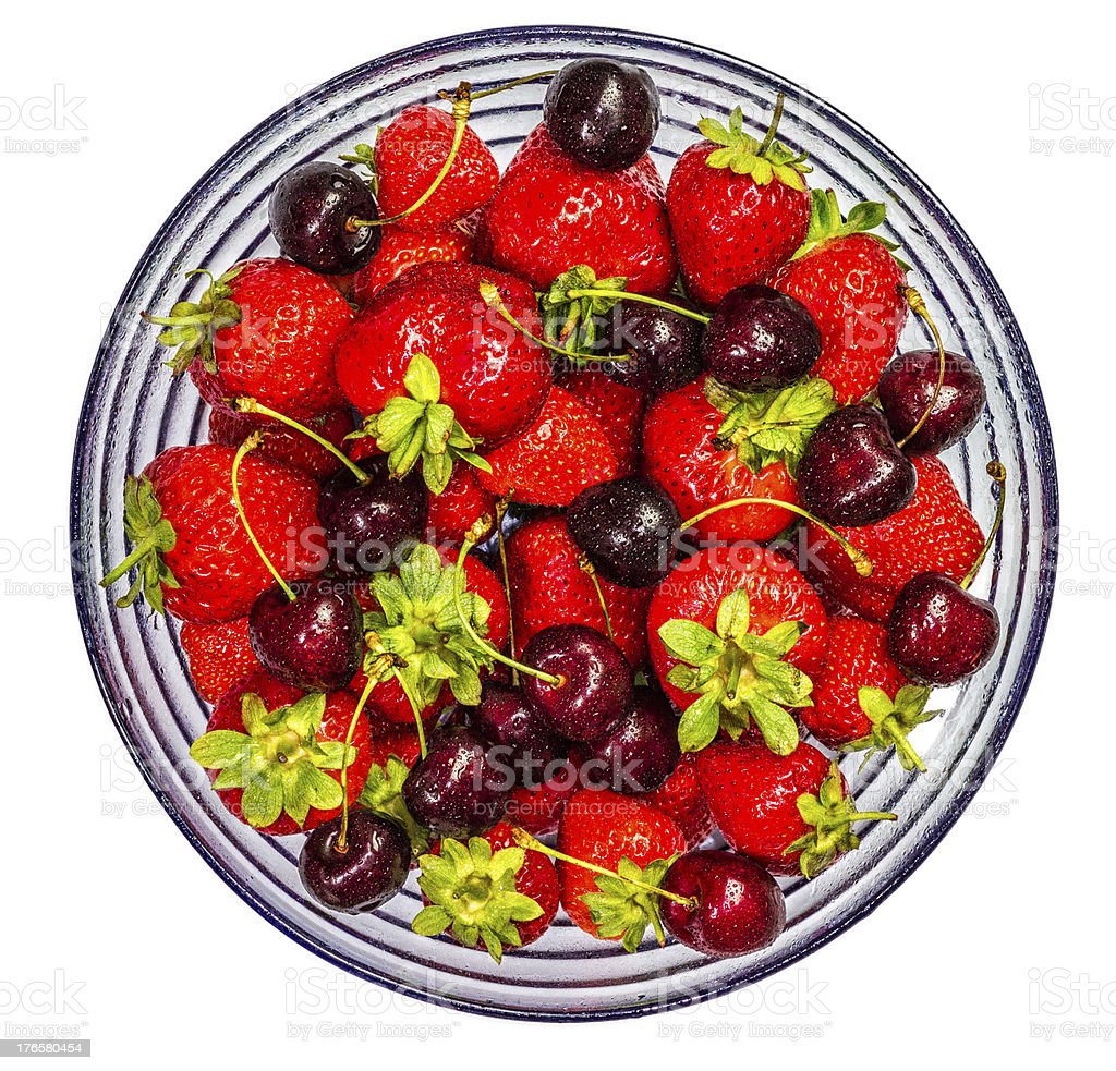 Strawberries and Cherries in a Glass Bowl stock photo
