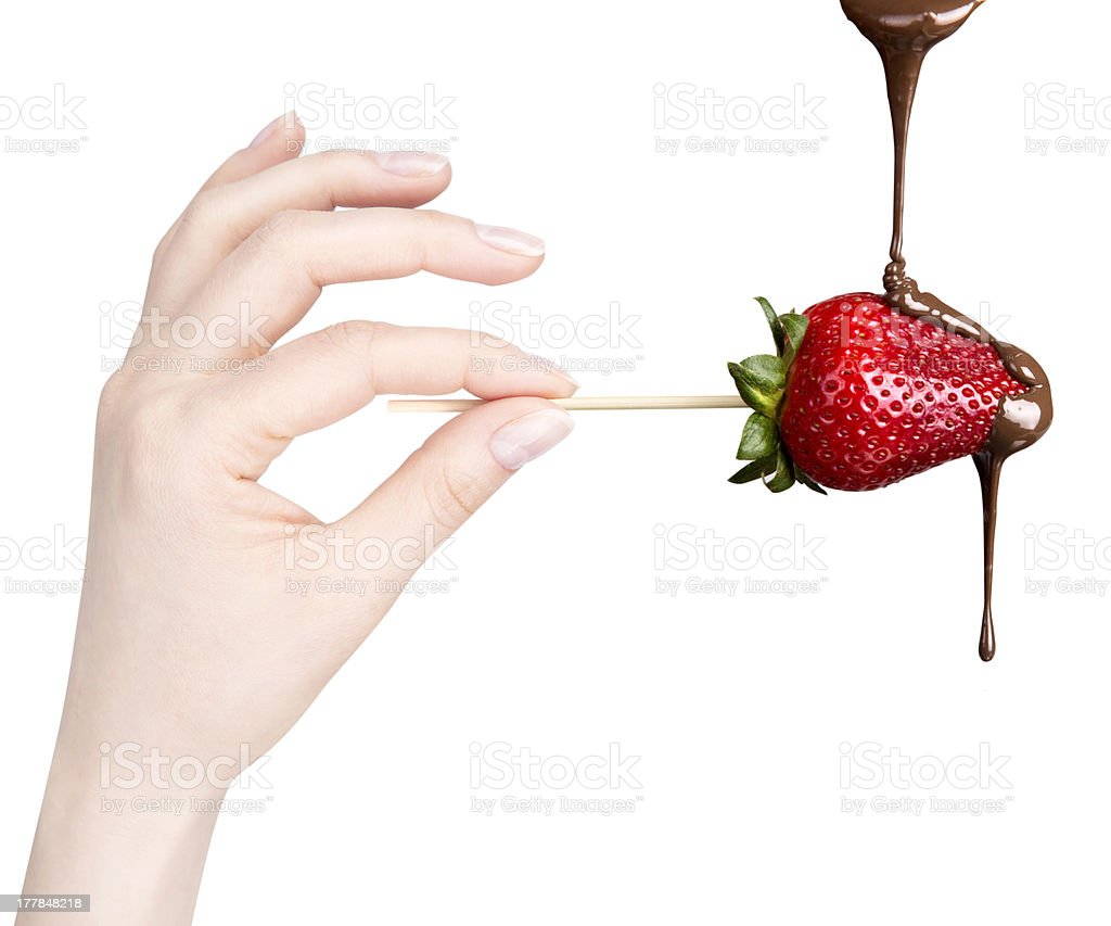 strawberries and chocolate with hand stock photo