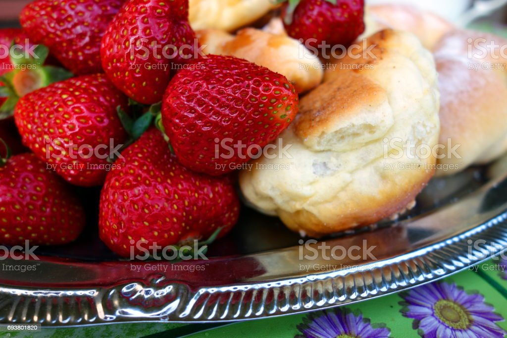 Strawberries and croissants stock photo