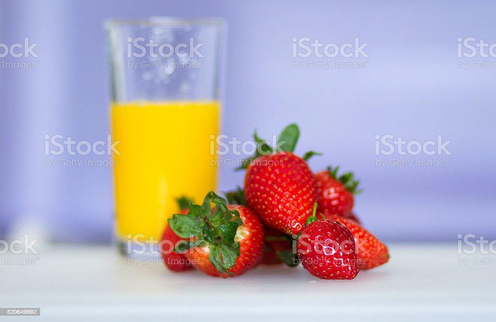 Strawberries and Orange Juice stock photo