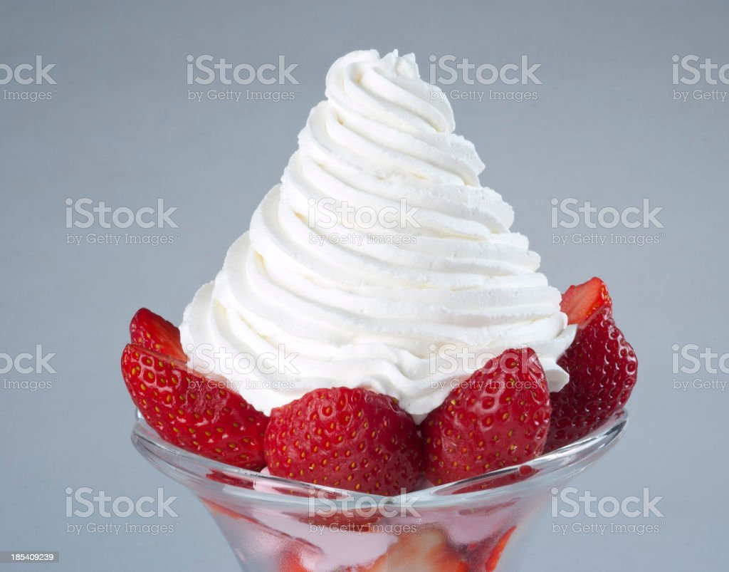 Strawberries and whip cream stock photo