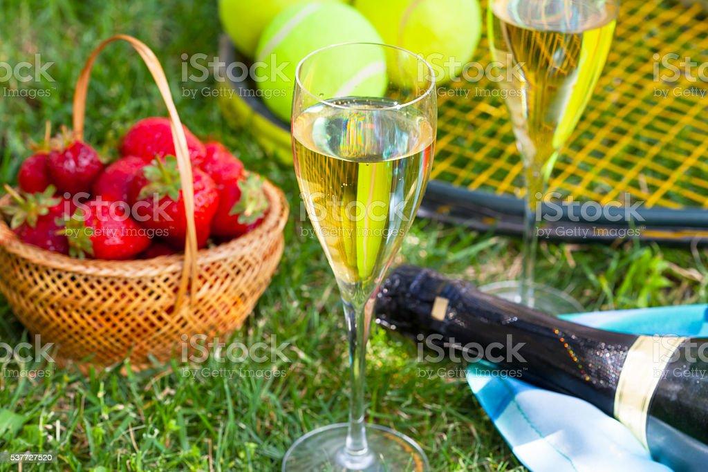 Strawberries, champagne and tennis balls stock photo