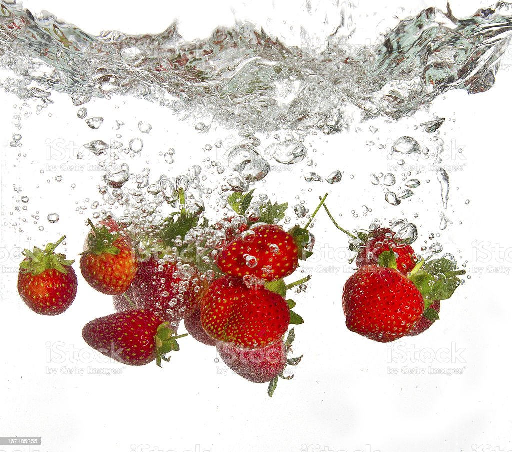 Strawberries falling into water royalty-free stock photo