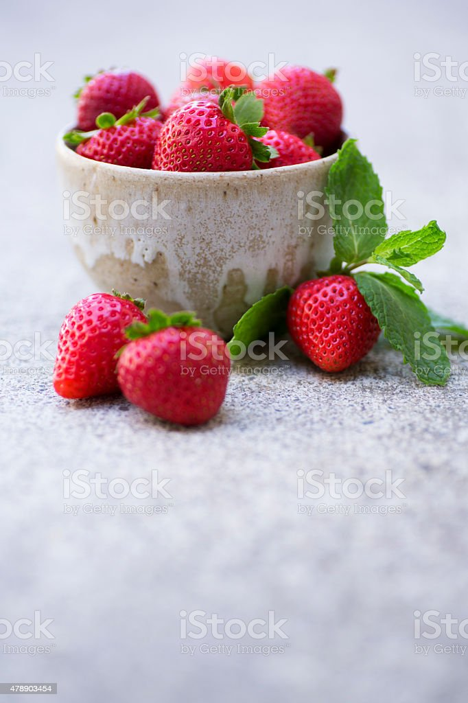 Strawberries in a Ceramic Bowl stock photo