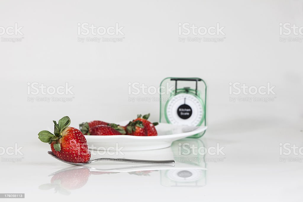 Strawberries in a plate with weight scale royalty-free stock photo