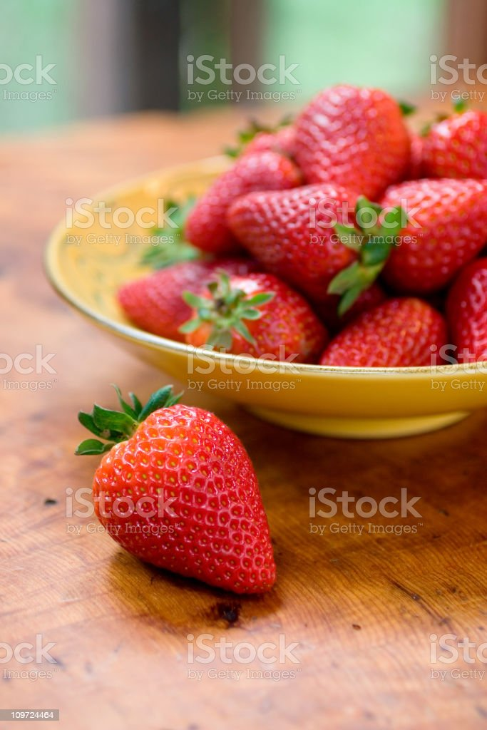 Strawberries in bowl stock photo