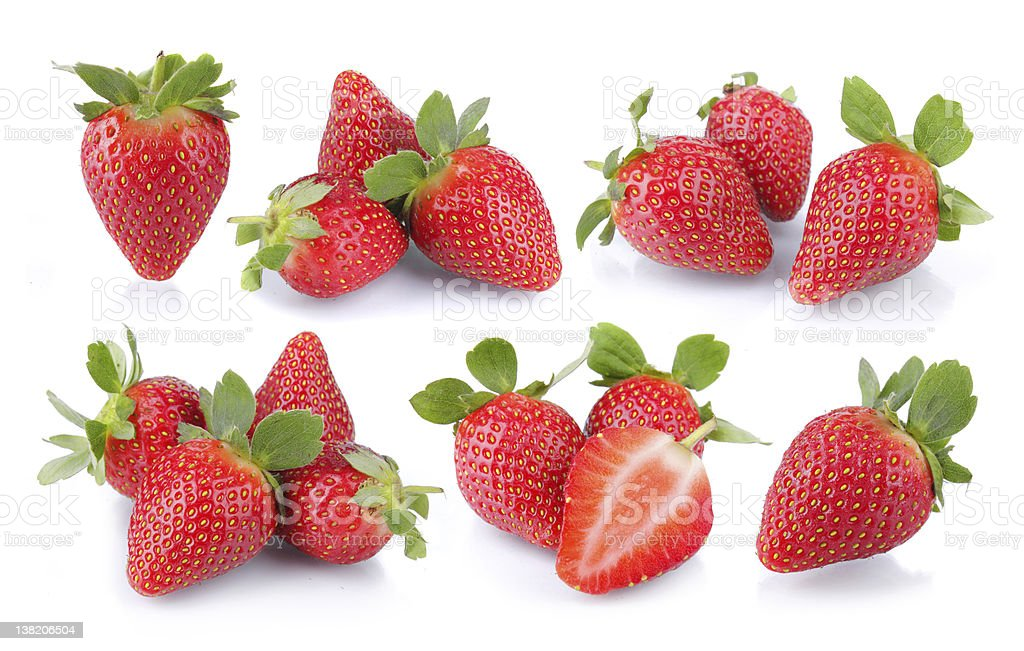 Strawberries in groups on white background stock photo