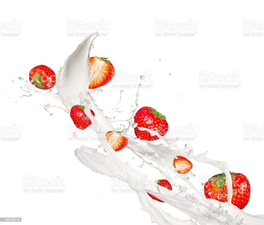 Strawberries in milk splash stock photo
