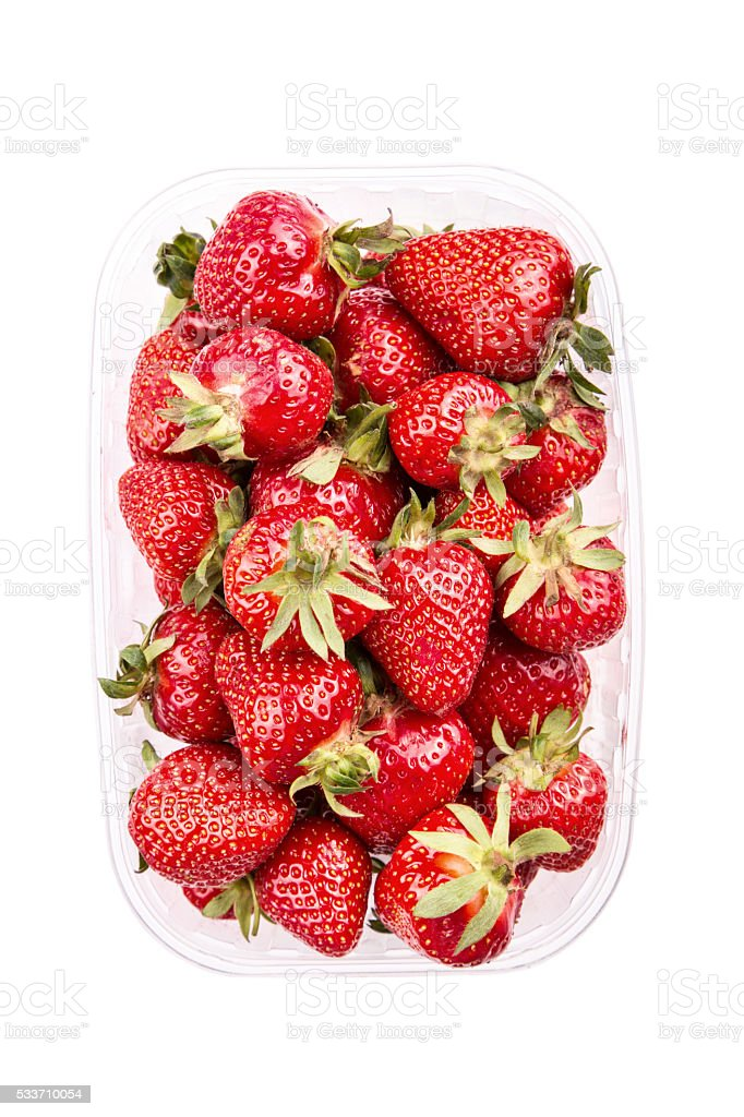 Strawberries in plastic box, isolated.File contains clipping paths. stock photo