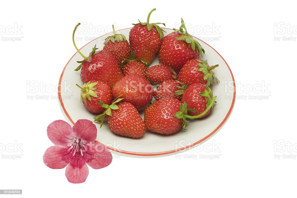 Strawberries on a saucer, isolated upon white, with clipping path stock photo