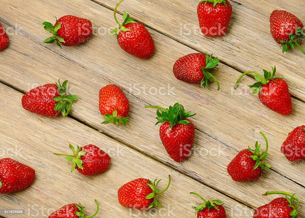 strawberries on a wooden  background stock photo